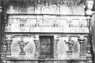 Sankeertana Bhandagaram in the temple complex. Annamacharya on the left and Peda Tirumalacharya on the right.